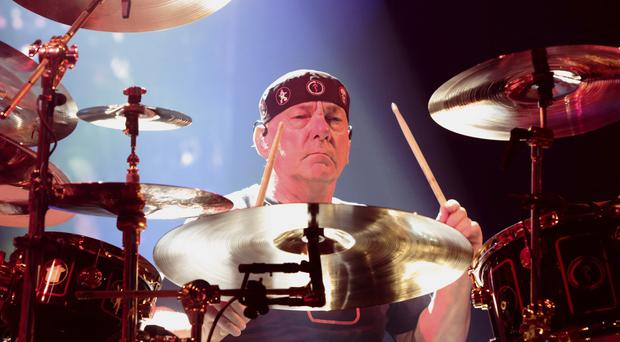 Foo Fighters frontman Dave Grohl has led the tributes to Rush drummer Neil Peart following his death at the age of 67 (Owen Sweeney/Invision/AP)