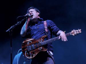 INDIO, CA - APRIL 12:  Musician Isaac Brock of the band Modest Mouse performs onstage during day 1 of the 2013 Coachella Valley Music & Arts Festival at the Empire Polo Club on April 12, 2013 in Indio, California.  (Photo by Kevin Winter/Getty Images for Coachella)