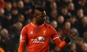 Liverpool's Italian striker Mario Balotelli gives a thumbs up after scoring Liverpool's third goal during the English Premier League football match between Liverpool and Tottenham Hotspur at the Anfield stadium. Photo: Paul Ellis/Getty Images