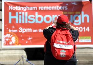 A Liverpool fan pays her respect to the victims of the Hillsborough disaster in Market Square, Nottingham. PRESS ASSOCIATION Photo. Picture date: Tuesday April 15, 2014. Photo credit: Rowan Staszkiewicz/PA Wire