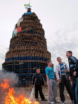 Pacemaker press Young men from the Shankill area of Belfast put the finishing touch on their bonfire's on the 11th of july. picture mark marlow