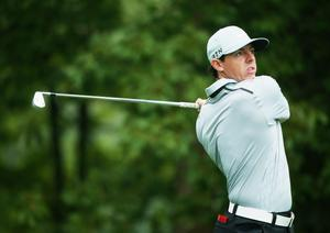 LOUISVILLE, KY - AUGUST 08:  Rory McIlroy of Northern Ireland watches his tee shot on the 11th hole during the weather-delayed second round of the 96th PGA Championship at Valhalla Golf Club on August 8, 2014 in Louisville, Kentucky.  (Photo by Andrew Redington/Getty Images)
