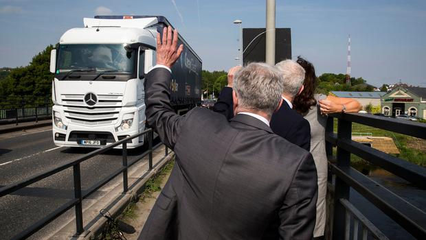 Labour leader Jeremy Corbyn (centre, obscured and back to camera) waves at a vehicle with Shadow Secretary of State for Northern Ireland Tony Lloyd (back to camera) during a visit to Lifford Bridge on the Irish border, during the second day of a two-day trip to learn more about how Brexit affects the country. PRESS ASSOCIATION Photo. Picture date: Friday May 25, 2018. See PA story ULSTER Corbyn. Photo credit should read: Liam McBurney/PA Wire