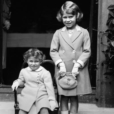 File photo dated 01/01/1933 of two year old Princess Margaret (seated) with her sister Princess Elizabeth (now Queen Elizabeth II) as the Queen turns 90 on the April 21st.
