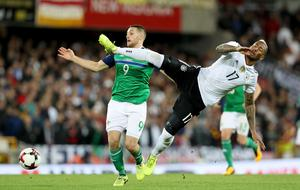 Northern Ireland's Conor Washington with Germany's Jerome Boateng during Thursdays World Cup Qualifier at the National Football Stadium at Windsor Park, Belfast.   Photo by William Cherry/Presseye