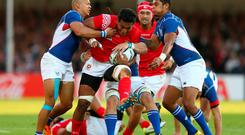 EXETER, ENGLAND - SEPTEMBER 29: Jack Ram of Tonga is tackled by Russel Van Wyk (L) of Namibia during the 2015 Rugby World Cup Pool C match between Tonga and Namibia at Sandy Park on September 29, 2015 in Exeter, United Kingdom. (Photo by Michael Steele/Getty Images)