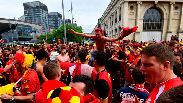 Belgium supporters cheer in the streets of Lille on July 1, 2016 before the Euro 2016 quarter-final football match between Wales and Belgium. / AFP PHOTO / EMMANUEL DUNANDEMMANUEL DUNAND/AFP/Getty Images
