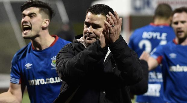 Linfield manager David Healy salutes the support after his side's win over Cliftonville.