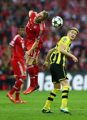 LONDON, ENGLAND - MAY 25:  Bastian Schweinsteiger of Bayern Muenchen (L) in action with Marco Reus of Borussia Dortmund during the UEFA Champions League final match between Borussia Dortmund and FC Bayern Muenchen at Wembley Stadium on May 25, 2013 in London, United Kingdom.  (Photo by Alex Grimm/Getty Images)