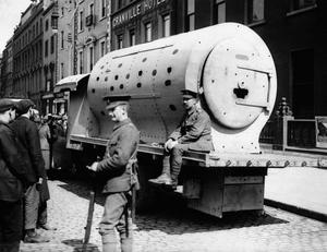 File photo dated 11/05/1916 of British soldiers guarding an improvised armoured car made from a locomotive boiler and used to convey troops from point to point during the 'Easter Rising'. PA