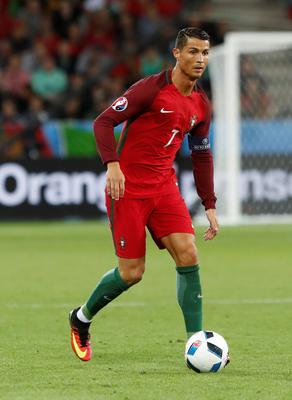 Portugal's Cristiano Ronaldo controls the ball during the Euro 2016 Group F soccer match between Portugal and Iceland at the Geoffroy Guichard stadium in Saint-Etienne, France, Tuesday, June 14, 2016. (AP Photo/Laurent Cipriani)