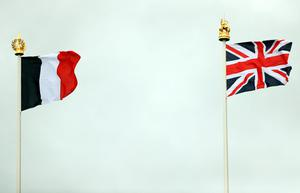 THIEPVAL, FRANCE - JULY 1:  A Union flag and French tricolour fly during the Commemoration of the Centenary of the Battle of the Somme at the Commonwealth War Graves Commission Thiepval Memorial on July 1, 2016 in Thiepval, France. The event is part of the Commemoration of the Centenary of the Battle of the Somme at the Commonwealth War Graves Commission Thiepval Memorial on July 1, 2016 in Thiepval, France. where 70,000 British and Commonwealth soldiers with no known grave are commemorated. (Photo by Chris Radburn - Pool/Getty Images)