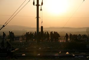 "This handout photograph taken and released by Caritas Internationalis on September 5, 2015 in Idomeni, northern Greece, shows migrants waiting to be allowed to cross the Greek-Macedonian border. More than 230,000 refugees and migrants have arrived in Greece by sea this year, a huge rise from 17,500 in the same period in 2014, shipping ministry said on September 3. AFP PHOTO / CARITAS INTERNATIONALIS / MATTHIEU ALEXANDRE  -- EDITORS NOTE -- RESTRICTED TO EDITORIAL USE - MANDATORY CREDIT ""AFP PHOTO/ MATTHIEU ALEXANDRE/CARITAS INTERNATIONALIS"" - NO MARKETING NO ADVERTISING CAMPAIGNS ----CAR04MATTHIEU ALEXANDRE/AFP/Getty Images"