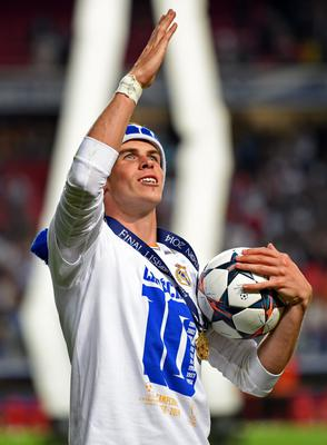 LISBON, PORTUGAL - MAY 24:  Gareth Bale of Real Madrid celebrates after winning the UEFA Champions League Final between Real Madrid and Atletico de Madrid at Estadio da Luz on May 24, 2014 in Lisbon, Portugal.  (Photo by Shaun Botterill/Getty Images)