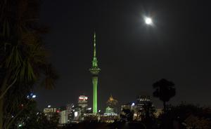 The Sky Tower in Auckland, New Zealand, illuminated in green as part of Tourism Irelands Global Greening initiative, to celebrate the island of Ireland and St Patrick.