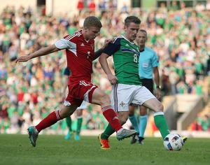 @Press Eye Ltd Northern Ireland- 27th May 2016 Mandatory Credit -Brian Little/Presseye  Northern Ireland   Steven Davis    and Belarus Nikita Korzun      during Friday night's Vauxhall Friendly International match  at the National Football Stadium at Windsor Park. Picture by Brian Little/Presseye