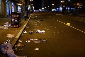 BOSTON, MA - APRIL 16: Debris and litter cover an empty street near the scene of a twin bombing at the Boston Marathon, on April 16, 2013 in Boston, Massachusetts. Three people are confirmed dead and at least 141 injured after the explosions went off near the finish line of the marathon yesterday. The bombings at the 116-year-old Boston race, resulted in heightened security across the nation with cancellations of many professional sporting events as authorities search for a motive to the violence. (Photo by Spencer Platt/Getty Images)