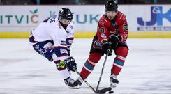 New Belfast Giants forward Elgin Pearce (left) in action against them earlier this season while with the Dundee Stars (William Cherry/Presseye)