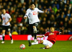 George Thorne of Derby County evades Jesse Lingard of Manchester United during the Emirates FA Cup fourth round match between Derby County and Manchester United at iPro Stadium on January 29, 2016 in Derby, England.