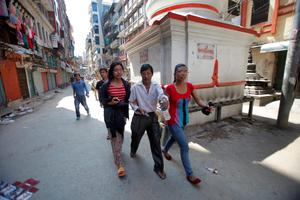 Nepalese people rush to safety after an earthquake hit Nepal in Kathmandu, Nepal, Tuesday, May 12, 2015. A major earthquake hit a remote mountainous region of Nepal on Tuesday, triggering landslides and toppling buildings less than three weeks after the country was ravaged by another deadly quake. (AP Photo/Bikram Rai)