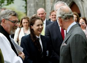 The Prince of Wales (right) talking to Bethany McLoughlin who was part of a choir that sang during a peace and reconciliation prayer service at St. Columba's Church in Drumcliffe on the second day of a four day visit to Ireland. PRESS ASSOCIATION Photo. Picture date: Wednesday May 20, 2015. See PA story ROYAL Ireland. Photo credit should read: Brian Lawless/PA Wire