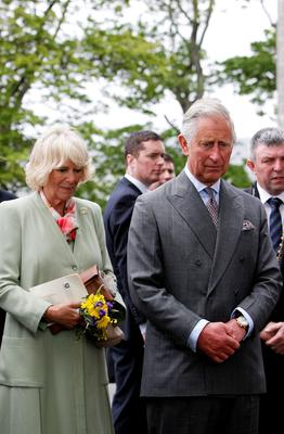 The Prince of Wales and the Duchess of Cornwall during a prayer following planting a London Oak after a service of peace and reconciliation at St. Columba's Church in Drumcliffe on the second day of a four day visit to Ireland. PRESS ASSOCIATION Photo. Picture date: Wednesday May 20, 2015. See PA story ROYAL Ireland. Photo credit should read: Brian Lawless/PA Wire
