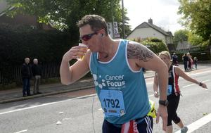 PACEMAKER BELFAST   03/05/2015 Thirsty work for Runners on the Antrim Road   during the Belfast Marathon 2015 takes place on Bank Holiday monday. Photo Colm Lenaghan/Pacemaker