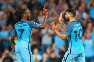 Sergio Aguero of Manchester City (R) celebrates with team mate Raheem Sterling as he scores their second goal from a penalty during the UEFA Champions League match between Manchester City FC and VfL Borussia Moenchengladbach at Etihad Stadium on September 14, 2016 in Manchester, England.  (Photo by Alex Livesey/Getty Images)