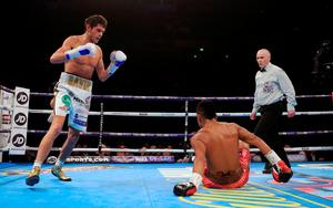 Gavin McDonnell (left) knocks down Jorge Sanchez during their Vacant WBC Silver & Eliminator Super-Bantamweight Championship bout at Manchester Arena.