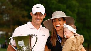 Rory McIlroy of Northern Ireland celebrates with the trophy alongside his wife Erica and daughter Poppy after winning during the final round of the 2021 Wells Fargo Championship at Quail Hollow Club on May 09, 2021 in Charlotte, North Carolina. (Photo by Jared C. Tilton/Getty Images)