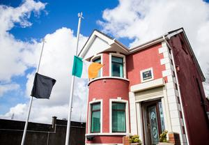 A black flag and the national flag of Ireland referred to as the Irish tricolour, fly at half mast at Connolly House, Andersonstown, Belfast following the death of Northern Ireland's former deputy first minister and ex-IRA commander Martin McGuinness aged 66. PRESS ASSOCIATION Photo. Picture date: Tuesday March 21, 2017. Mr McGuinness stood down in January in protest at the DUP's handling of the 'cash for ash' energy scandal, triggering a snap election. See PA story DEATH McGuinness. Photo credit should read: Liam McBurney/PA Wire