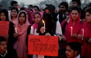 Pakistani students participate in a candle light vigil for victims killed in a Taliban attack on a military-run school in Islamabad, Pakistan, Wednesday, Dec. 17, 2014. Pakistan mourned as the nation prepares for mass funerals Wednesday for over 140 people, most of them children, killed in the Taliban massacre in a military-run school in the countrys northwest in the deadliest and most horrific attacks in years, officials said. (AP Photo/Anjum Naveed)