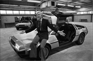 John DeLorean sitting on the bonnet of his car in 1981