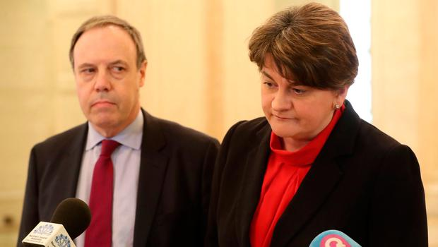 DUP's Nigel Dodds (left) and leader Arlene Foster speak to members of he media in the Great Hall in Parliament Building in Stormont, Belfast, where talks aimed at restoring Northern Ireland's powersharing government have resumed. PA