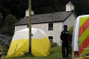File photo dated 7/10/2012 of Police at the home of Mark Bridger, as the hunt for missing April Jones continues around Machynlleth, mid Wales. Former slaughterhouse worker Mark Bridger has been found guilty of abducting and murdering schoolgirl April Jones