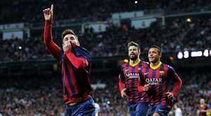 Lionel Messi of Barcelona celebrates scoring his team's fourth goal during the La Liga match between Real Madrid CF and FC Barcelona at the Bernabeu on March 23, 2014 in Madrid, Spain.  (Photo by Denis Doyle/Getty Images)