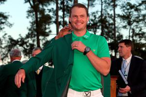 Danny Willett celebrates with the green jacket after winning the final round of the 2016 Masters Tournament at Augusta