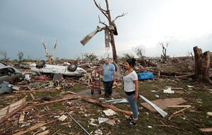 MOORE, OK- MAY 20:  Philip Gotcher and his daughter Monica stand in the rubble of his house after a powerful tornado ripped through the area on May 20, 2013 in Moore, Oklahoma. The tornado, reported to be at least EF4 strength and two miles wide, touched down in the Oklahoma City area on Monday killing at least 51 people. (Photo by Brett Deering/Getty Images)