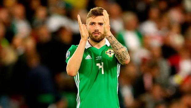 Northern Ireland's Stuart Dallas acknowledges the fans after the final whistle of Northern Ireland's game against Germany.