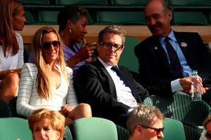LONDON, ENGLAND - JULY 10:  Hugh Grant watches on during the Men's Singles Final match between Andy Murray of Great Britain and Milos Raonic of Canada on day thirteen of the Wimbledon Lawn Tennis Championships at the All England Lawn Tennis and Croquet Club on July 10, 2016 in London, England.  (Photo by Julian Finney/Getty Images)