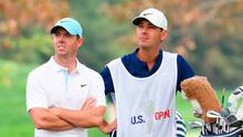 Keeping focus: Rory McIlroy and caddy Harry Diamond look on from the 18th tee during the first round of the 120th US Open at Winged Foot
