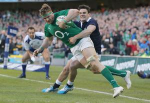 DUBLIN, IRELAND - FEBRUARY 02:  Max Evans of scotland tries to tackle Jamie Heaslip of Ireland during RBS Six Nations match between Ireland and Scotland at the Aviva Stadium on February 2, 2014 in Dublin, Ireland.  (Photo by Ian Walton/Getty Images)
