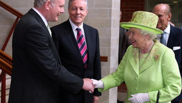 PACEMAKER BELFAST   27/6/12 Queen Elizabeth II shakes hands with Northern Ireland Deputy First Minister Martin McGuinness watched by First minister Peter Robinson (centre) at the Lyric Theatre in Belfast.  POOL PICTURE PA/PACEMAKER PRESS