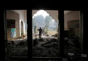 A Pakistan army soldier inspects the Army Public School attacked the day before by Taliban gunmen in Peshawar, Pakistan, Wednesday, Dec. 17, 2014. Pakistan mourned as the nation prepares for mass funerals Wednesday for over 140 people, most of them children, killed in the Taliban massacre in the military-run school in the country's northwest in the deadliest and most horrific attacks in years, officials said. (AP Photo/B.K. Bangash)