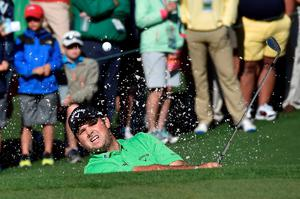 US golfer Patrick Reed hits out of a bunker on the 2nd hole during Round 1 of the 80th Masters Golf Tournament at the Augusta National Golf Club on April 7, 2016, in Augusta, Georgia.   / AFP PHOTO / Nicholas KammNICHOLAS KAMM/AFP/Getty Images