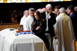 Ashley Donohoe looks at her sister's casket during a service for Olivia Burke, 21, and Ashley Donohoe, 22, at St. Joseph Catholic Church in Cotati, Calif., on Saturday, June 20, 2015.  The two woman were among the several people killed on Tuesday when a balcony snapped off the fifth floor of a Berkeley apartment building during a birthday party. (AP Photo/Michael Short)