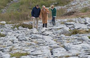 Mcc0062419 ??Eddie Mulholland eddie_mulholland@hotmail.com 07831257107 The Prince of Wales visiting the Burren, Galway to explore it's rare landscape and to learn about the challenges facing it's farming community. He met students and conservation volunteers, watched local children playing traditional music and was presented with a hamper of local produce. PIC: HRH with Brendan Dunford manager of Burren Life and Bridgid Barry Burrenbeo