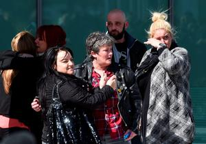 Relatives hug outside the Hillsborough inquests in Warrington, where the inquest jury concluded that the 96 Liverpool fans who died in the Hillsborough disaster were unlawfully killed. PRESS ASSOCIATION Photo. Picture date: Tuesday April 26, 2016. See PA story INQUEST Hillsborough. Photo credit should read: Joe Giddens/PA Wire