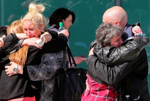 Relatives of the victims of the 1989 Hillsborough disaster react following the conclusion of the inquest into the disaster, at the coroner's court in Warrington, north-west England on April 26, 2016. The 96 Liverpool fans who died in Britain's 1989 Hillsborough football stadium disaster were unlawfully killed, a jury found Tuesday following the longest-running inquest in English legal history. After hearing more than two years of evidence, the jury also concluded that the behaviour of Liverpool supporters on the day did not cause or contribute to Britain's worst sports stadium tragedy.  / AFP PHOTO / GEOFF CADDICKGEOFF CADDICK/AFP/Getty Images