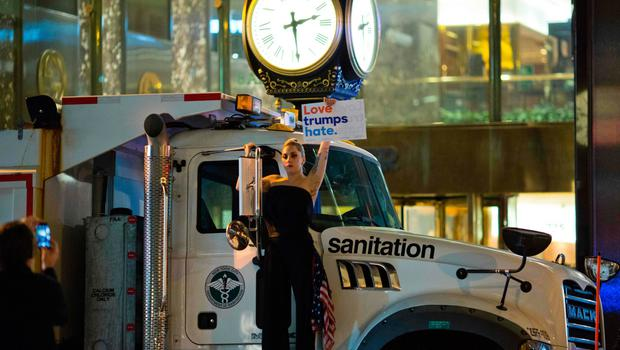 Musician Lagy Gaga stages a protest against Republican presidential nominee Donald Trump on a sanitation truck outside Trump Tower in New York City after midnight on election day November 9, 2016. AFP/Getty Images